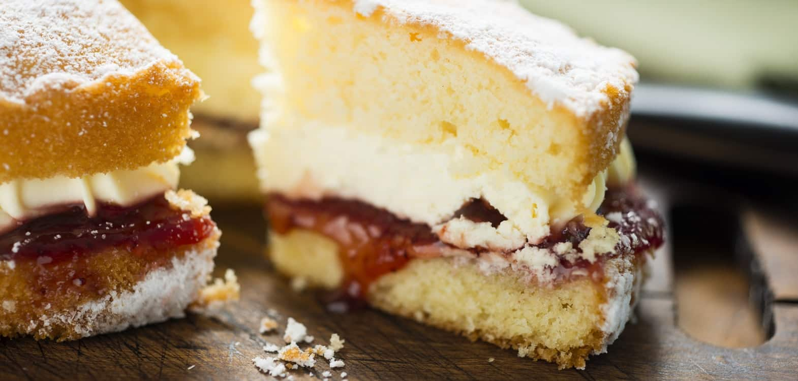 Victoria sandwich sponge cake slice with cream and jam, served at Firhall Highland B&B