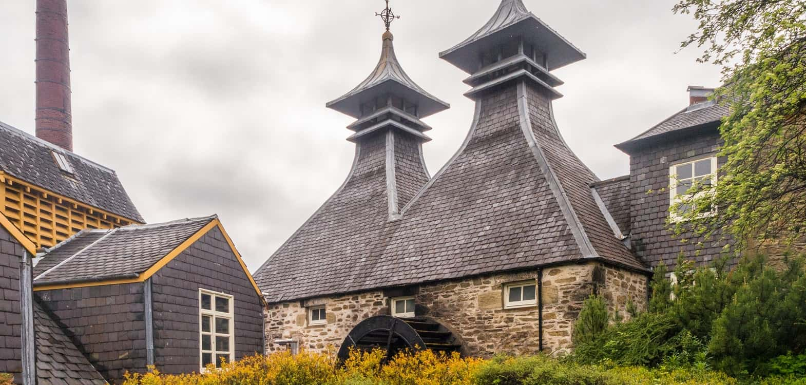Distillery towers and roofs of buildings in the Highlands of Scotland