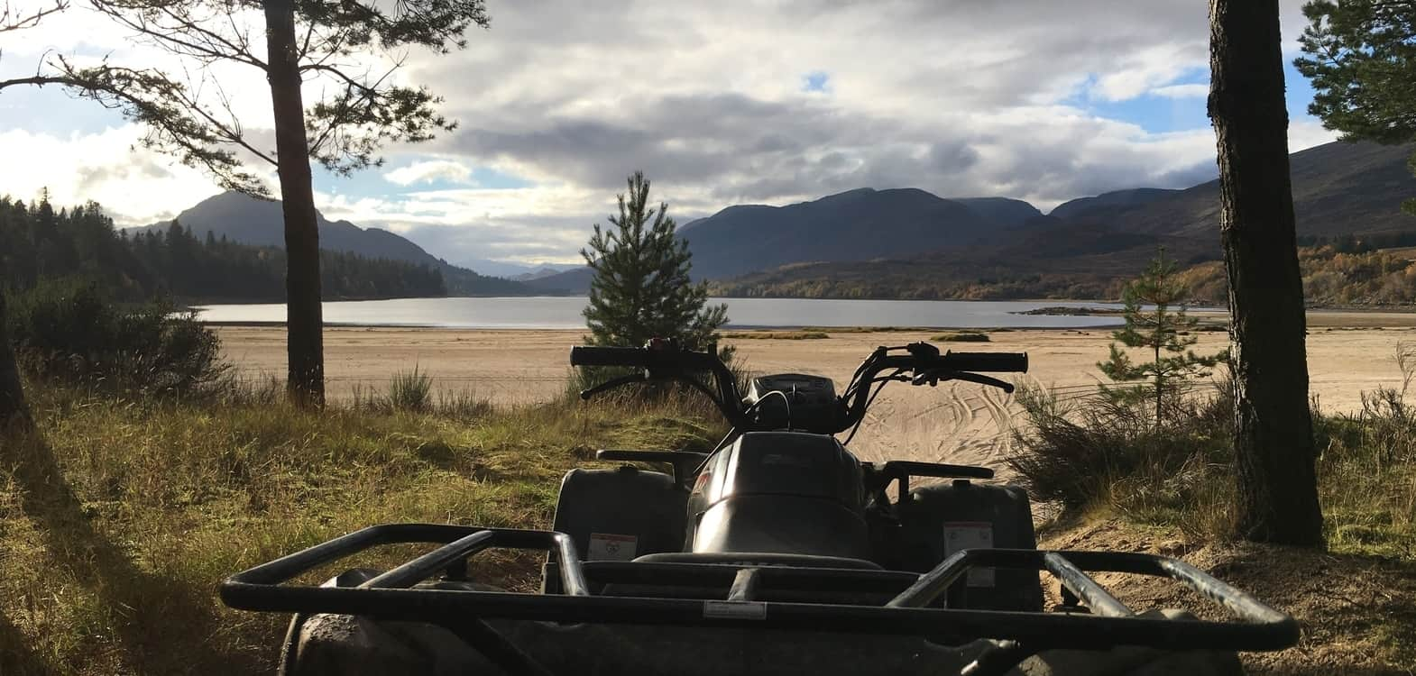 Quad bike overlooking the sandy beach next to a Highland loch, a great day out from Firhall bed and breakfast