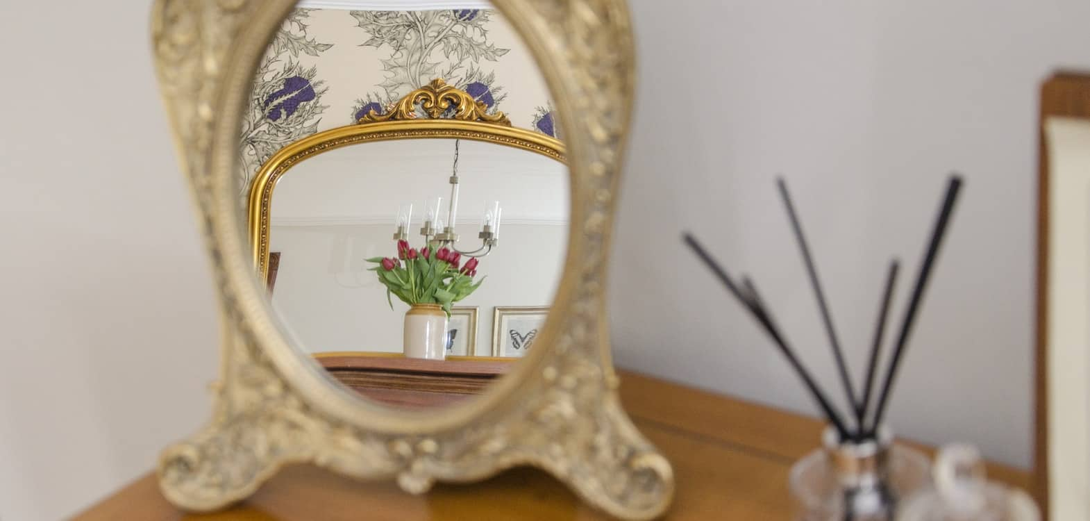 Looking into a mirror image of the Spey bedroom interior at Firhall Highland B&B